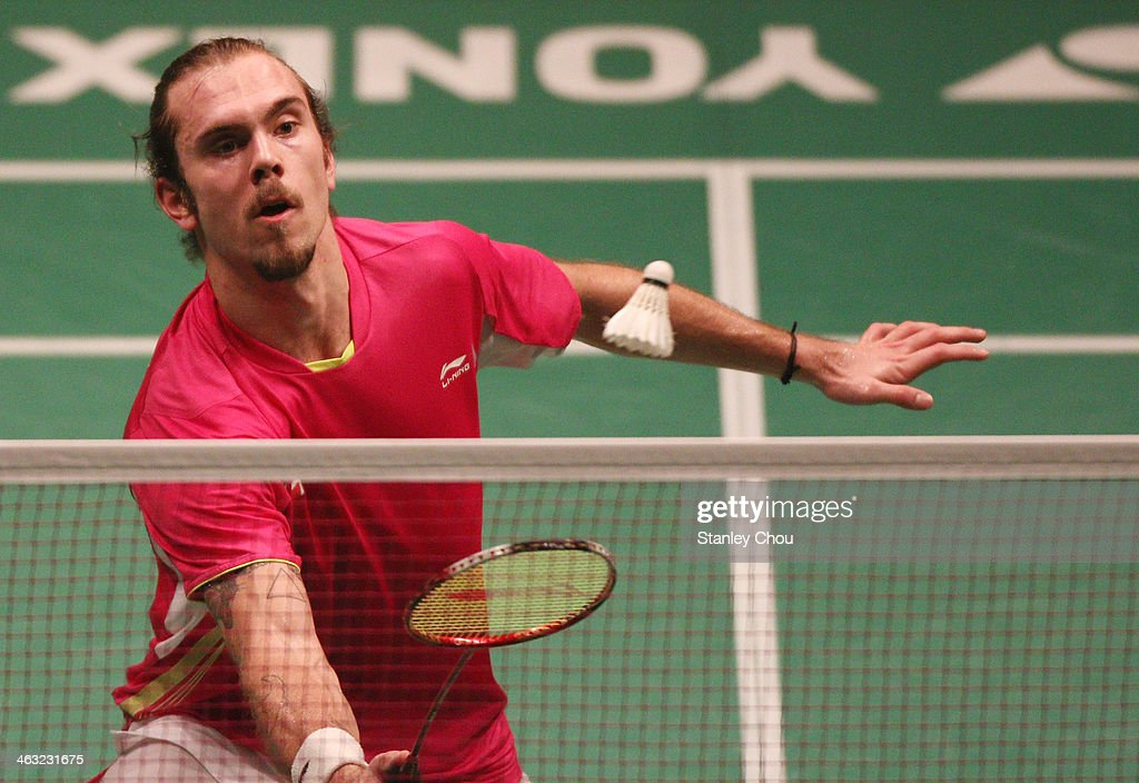 Jan O Jorgensen of Denmark plays a shot to Kento Momota of Japan during day four of the Men's Singles of the Malaysia Badminton Open on January 17, 2014 in Kuala Lumpur, Malaysia.
