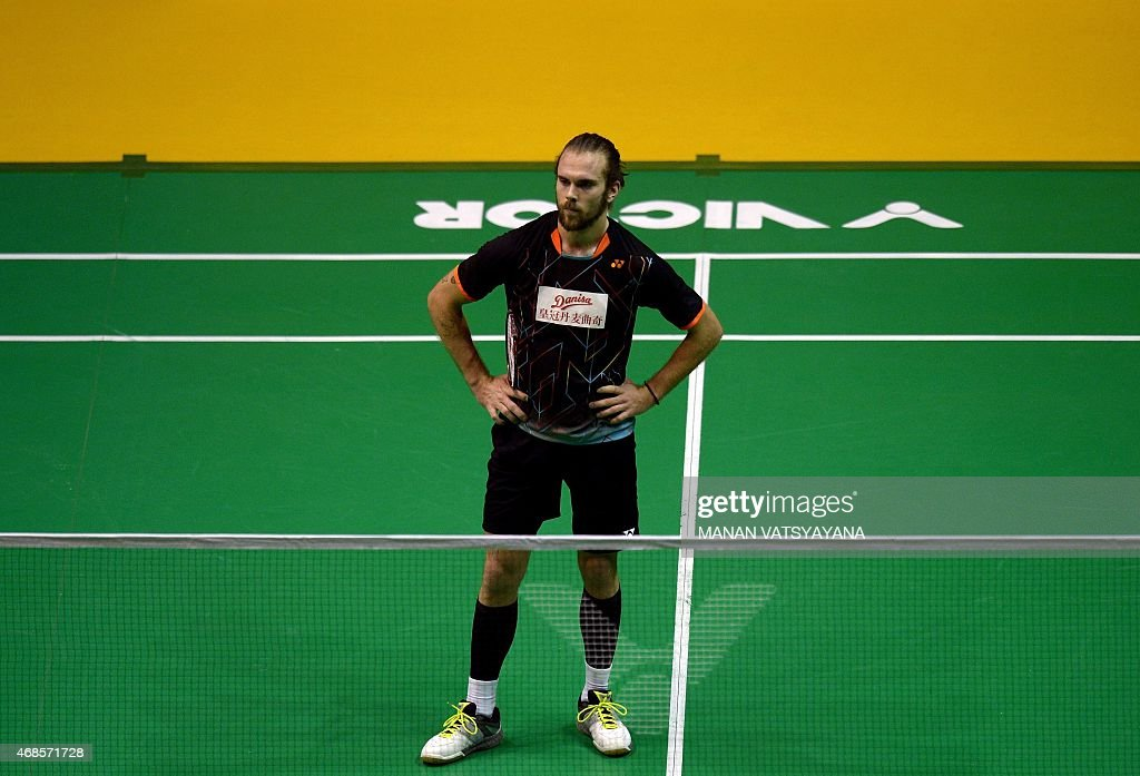 Jan O Jorgensen of Denmark reacts after losing a point against China's Lin Dan during their men's singles semi-final match at the 2015 Malaysia Open Badminton Superseries in Kuala Lumpur on April 4, 2015. AFP PHOTO / MANAN VATSYAYANA