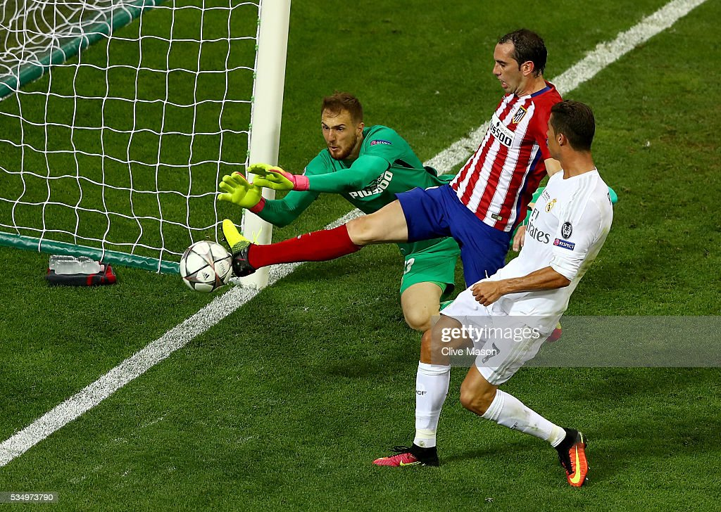 <a gi-track='captionPersonalityLinkClicked' href=/galleries/search?phrase=Jan+Oblak&family=editorial&specificpeople=8900856 ng-click='$event.stopPropagation()'>Jan Oblak</a> and <a gi-track='captionPersonalityLinkClicked' href=/galleries/search?phrase=Diego+Godin&family=editorial&specificpeople=608999 ng-click='$event.stopPropagation()'>Diego Godin</a> of Atletico Madrid combine to stop a chance on goal under pressure from Cristiano Ronaldo of Real Madrid during the UEFA Champions League Final match between Real Madrid and Club Atletico de Madrid at Stadio Giuseppe Meazza on May 28, 2016 in Milan, Italy.