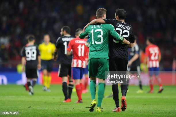 Jan Oblak of Atletico Madrid and Elvin Yunuszada of Qarabag FK hug after the UEFA Champions League group C match between Atletico Madrid and Qarabag...