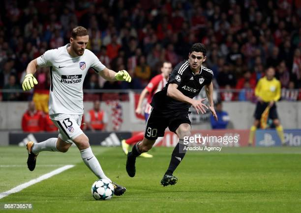 Jan Oblak of Atletico Madrid in action against Ramil Sheydaev of Qarabag FK during the UEFA Champions League Group C soccer match between Atletico...