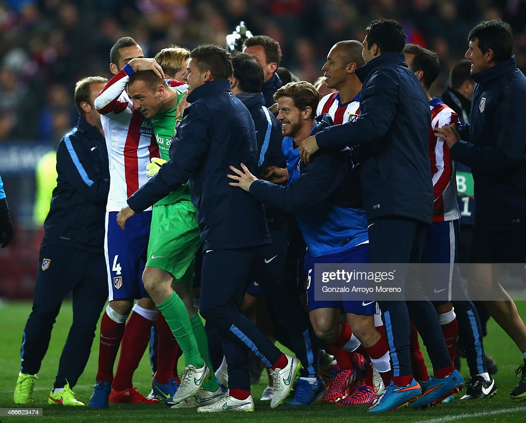Jan Oblak of Atletico Madrid is mobbed by team mates after the penalty shoot out during the UEFA Champions League round of 16 match between Club Atletico de Madrid and Bayer 04 Leverkusen at Vicente Calderon Stadium on March 17, 2015 in Madrid, Spain.