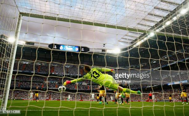 Jan Oblak of Atletico Madrid makes a save during the UEFA Champions League semi final first leg match between Real Madrid CF and Club Atletico de...