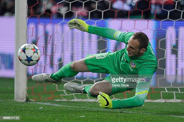 Jan Oblak of Club Atletico de Madrid saves a penalty during the penalty shootout after extra time in the the UEFA Champions League Round of 16 2nd...