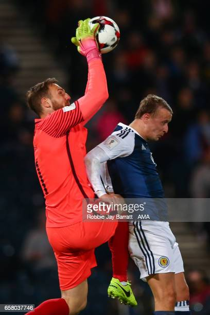 Jan Oblak of Slovenia and Leigh Griffiths of Scotland during the FIFA 2018 World Cup Qualifier between Scotland and Slovenia at Hampden Park on March...