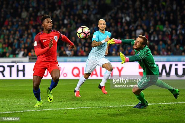 Jan Oblak of Slovenia dives for the ball under pressure from Daniel Sturridge of England during the FIFA 2018 World Cup Qualifier Group F match...
