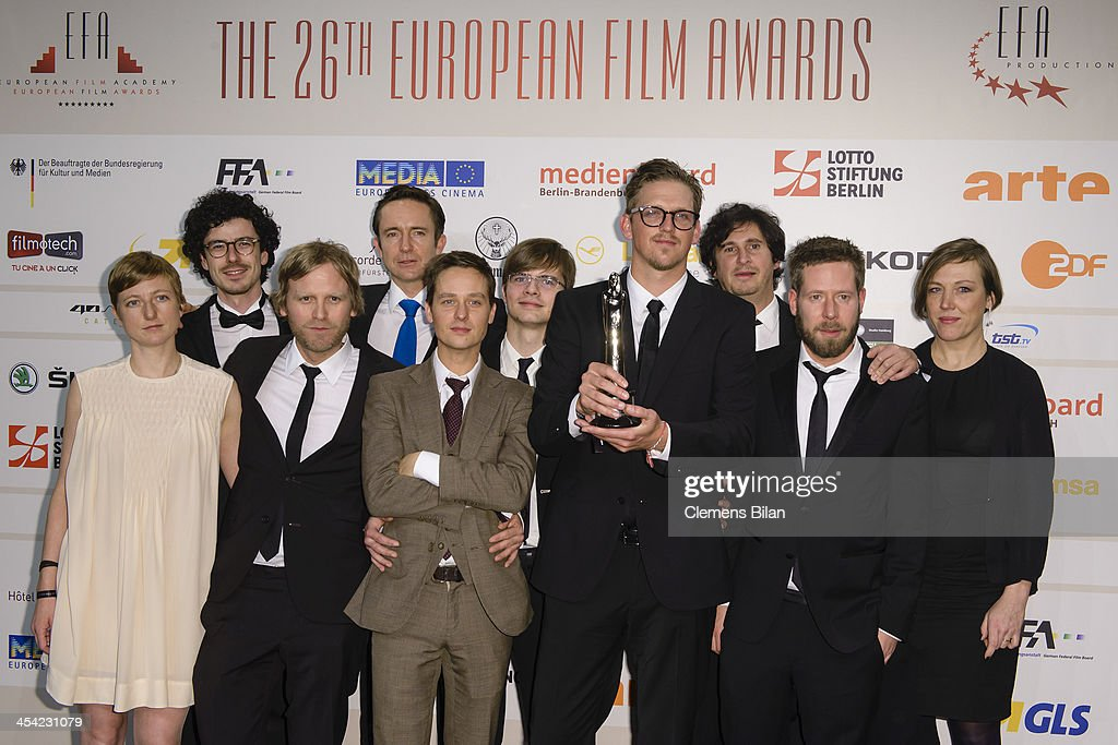 Jan Ole Gerster (C) and castmembers pose with the award for European Discovery 2013 at the European Film Awards 2013 on December 7, 2013 in Berlin, Germany.