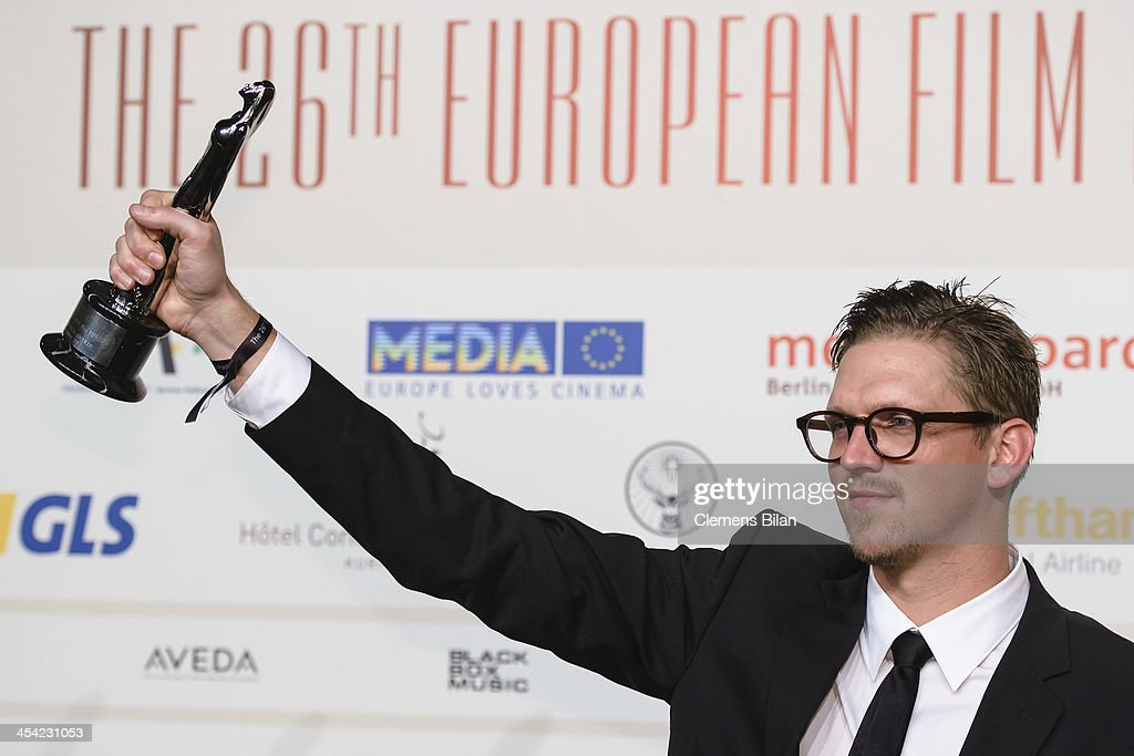 Jan Ole Gerster poses with his award for European Discovery 2013 at the European Film Awards 2013 on December 7, 2013 in Berlin, Germany.