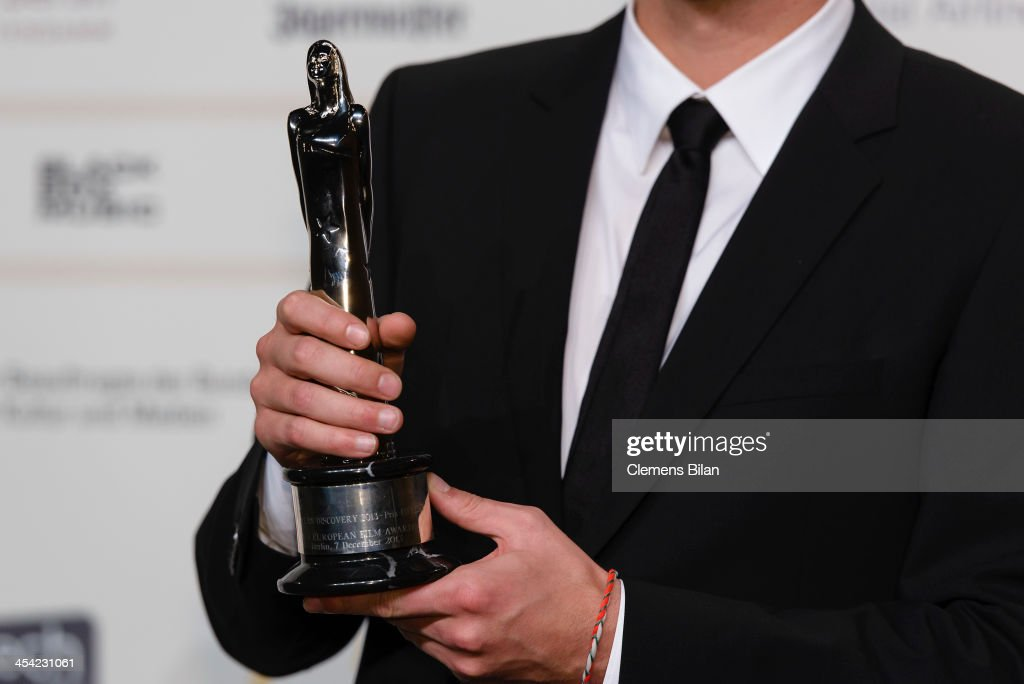 Jan Ole Gerster (award detail) poses with his award for European Discovery 2013 at the European Film Awards 2013 on December 7, 2013 in Berlin, Germany.