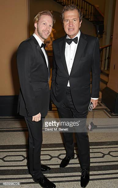 Jan Olesen and Mario Testino attend the Alexander McQueen Savage Beauty Fashion Gala at the VA presented by American Express and Kering on March 12...