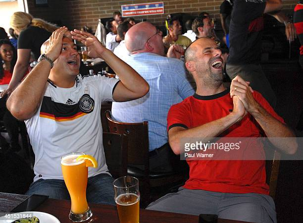 Jan Ostermann orginally of Neubrandenburg Germany reacts while watching the Germany vs Algeria World Cup match at the Red Fox English Pub in Royal...