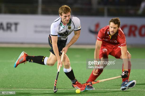 Jan Philipp Rabente of Germany and Nicolas De Kerpel of Belgium during day 9 of the FIH Hockey World League Men's Semi Finals final match between...