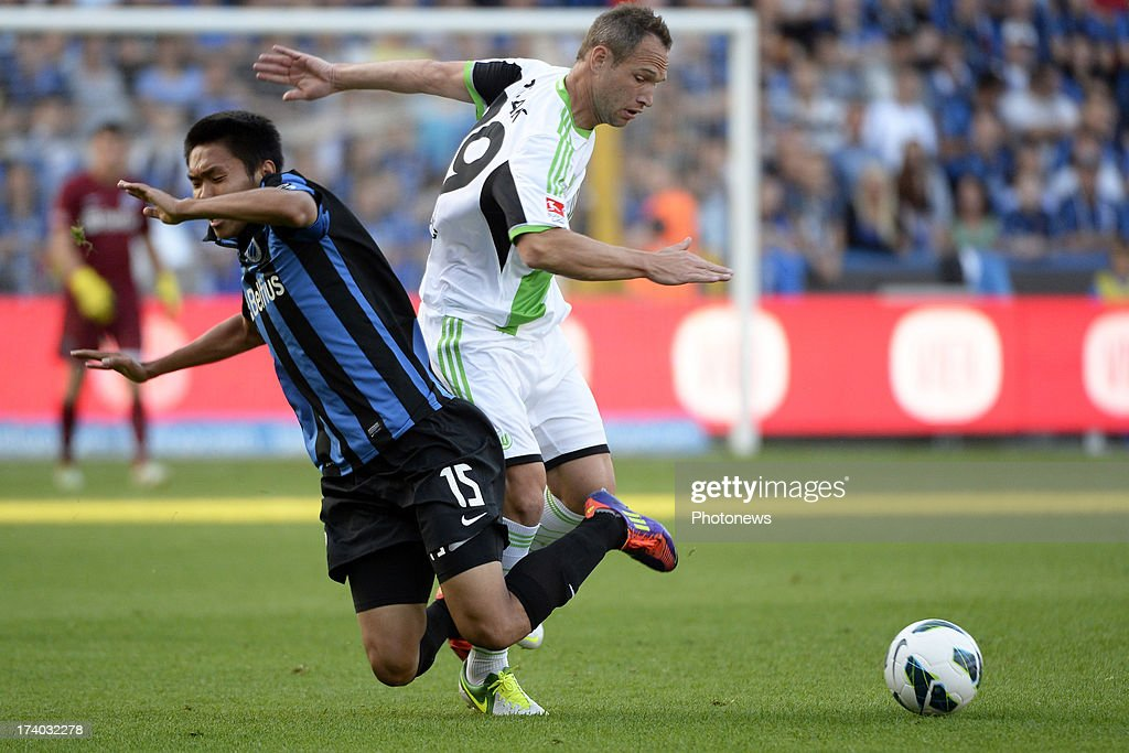 Jan Polak of Wolfsburg and Wang Shangyuan of Club Brugge K.V. compete for the ball during the friendly match between Club Brugge K.V. and Wolfsburg on July 19, 2013 in Bruges, Belgium.
