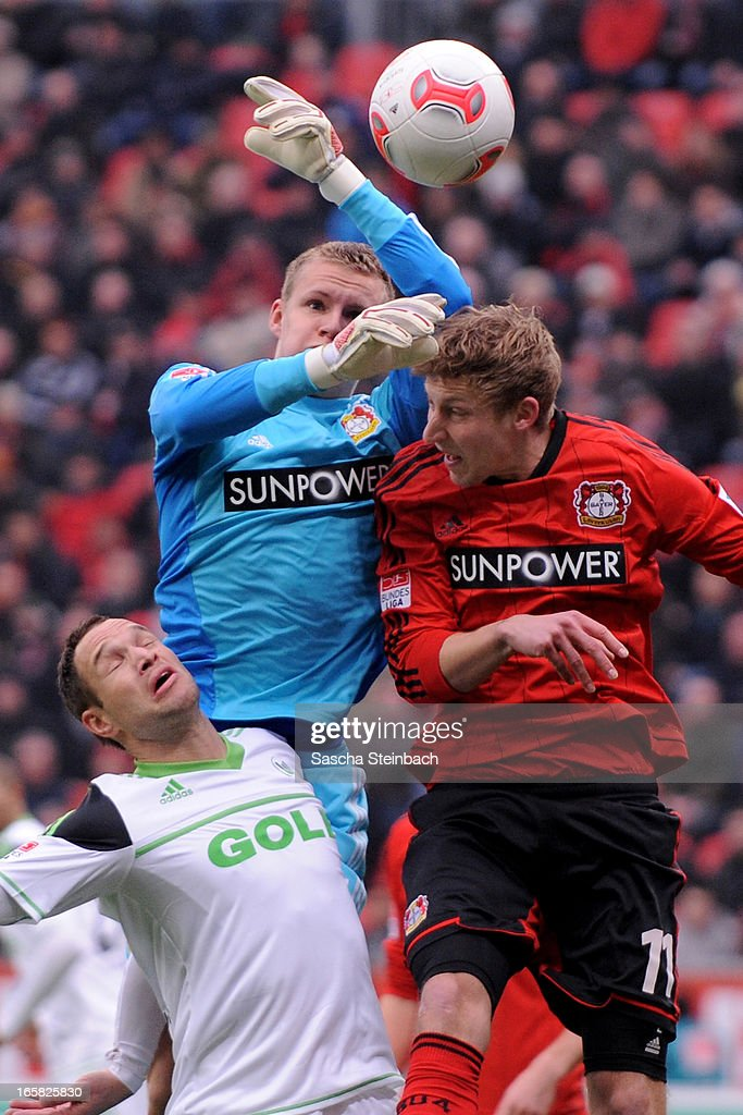 Jan Polak of Wolfsburg (L) battles for and header with Goalkeeper Bernd Leno (C) and Stefan Kiessling of Leverkusen (R) during the Bundesliga match between Bayer 04 Leverkusen and VfL Wolfsburg at BayArena on April 6, 2013 in Leverkusen, Germany.