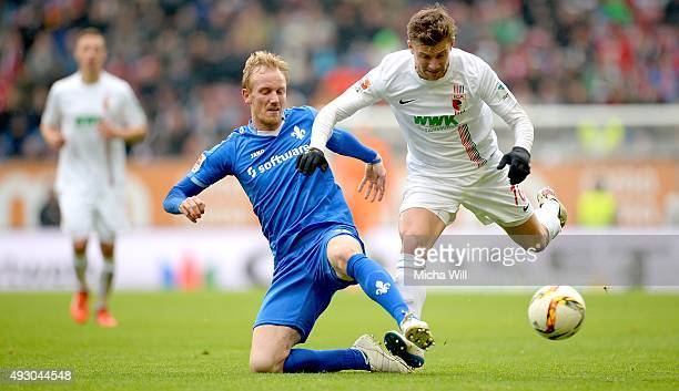 Jan Rosenthal of Darmstadt and Daniel Baier of Augsburg compete for the ball during the Bundesliga match between FC Augsburg and SV Darmstadt 98 at...