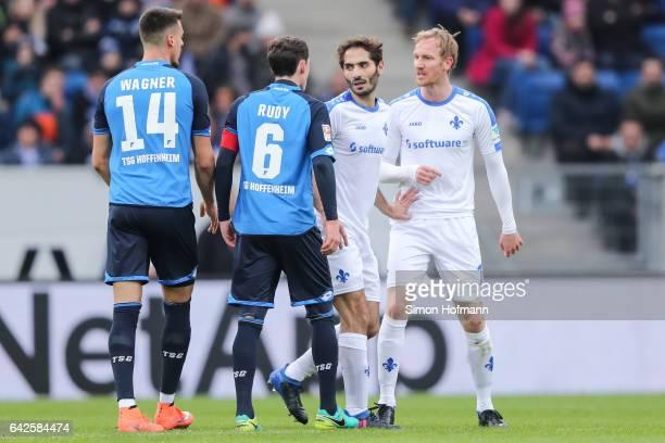 Jan Rosenthal of Darmstadt argues with Sebastian Rudy of Hoffenheim during the Bundesliga match between TSG 1899 Hoffenheim and SV Darmstadt 98 at...