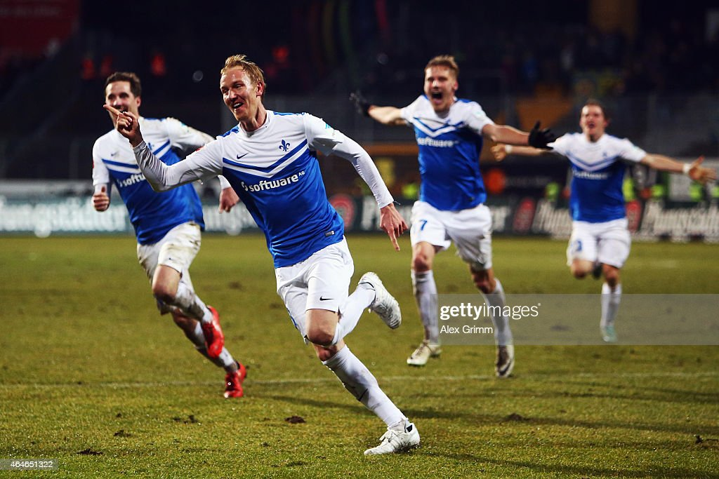 <a gi-track='captionPersonalityLinkClicked' href=/galleries/search?phrase=Jan+Rosenthal&family=editorial&specificpeople=758564 ng-click='$event.stopPropagation()'>Jan Rosenthal</a> of Darmstadt celebrates his team's first goal with team mates during the Second Bundesliga match between SV Darmstadt 98 and Eintracht Braunschweig at Merck-Stadion am Boellenfalltor on February 27, 2015 in Darmstadt, Germany.