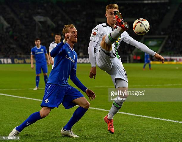 Jan Rosenthal of Darmstadt is challenged by Oscar Wendt of Moenchengladbach during the Bundesliga match between Borussia Moenchengladbach and SV...