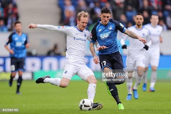 Jan Rosenthal of Darmstadt is challenged by Steven Zuber of Hoffenheim during the Bundesliga match between TSG 1899 Hoffenheim and SV Darmstadt 98 at...
