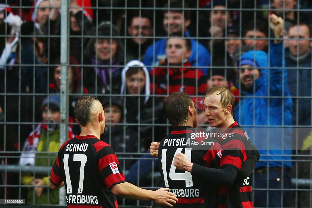 <a gi-track='captionPersonalityLinkClicked' href=/galleries/search?phrase=Jan+Rosenthal&family=editorial&specificpeople=758564 ng-click='$event.stopPropagation()'>Jan Rosenthal</a> (C) of Freiburg celebrates his team's first goal with team mates Anton Putsila and Jonathan Schmid (R-L) during the Bundesliga match between SC Freiburg and Borussia Dortmund at Badenova Stadium on December 17, 2011 in Freiburg im Breisgau, Germany.