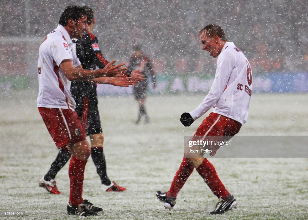 <a gi-track='captionPersonalityLinkClicked' href=/galleries/search?phrase=Jan+Rosenthal&family=editorial&specificpeople=758564 ng-click='$event.stopPropagation()'>Jan Rosenthal</a> of Freiburg celebrates with his team mate <a gi-track='captionPersonalityLinkClicked' href=/galleries/search?phrase=Stefan+Reisinger&family=editorial&specificpeople=706658 ng-click='$event.stopPropagation()'>Stefan Reisinger</a> after scoring his team's first goal during the Bundesliga match between Bayer Leverkusen and SC Freiburg at BayArena on December 19, 2010 in Leverkusen, Germany.