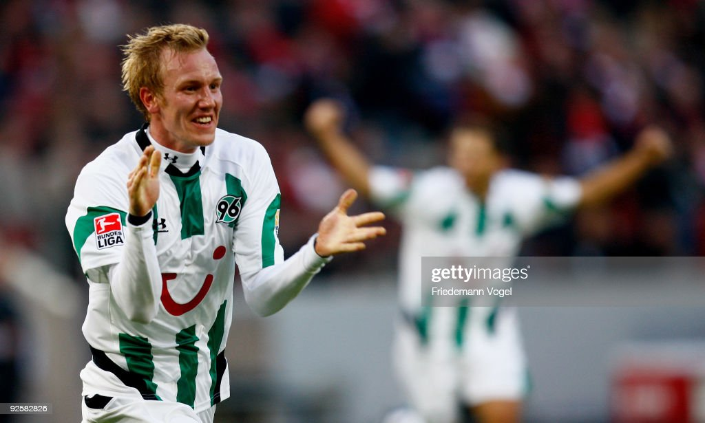 <a gi-track='captionPersonalityLinkClicked' href=/galleries/search?phrase=Jan+Rosenthal&family=editorial&specificpeople=758564 ng-click='$event.stopPropagation()'>Jan Rosenthal</a> (L) of Hannover celebrates after scoring the first goal during the Bundesliga match between 1. FC Koeln and Hannover 96 at the Rhein Energie Stadium on October 31, 2009 in Cologne, Germany.