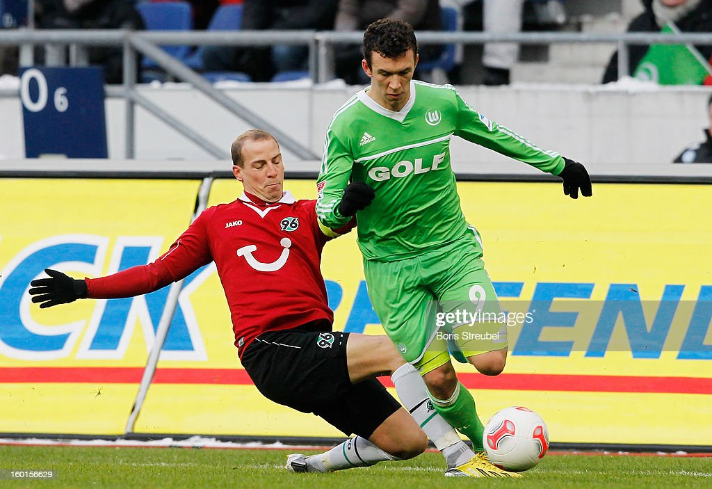 Jan Schlaudraff (L) of Hannover and Ivan Perisic (R) of Wolfsburg battle for the ball during the Bundesliga match between Hannover 96 and VfL Wolfsburg at AWD Arena on January 26, 2013 in Hannover, Germany.