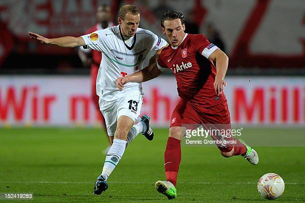 Jan Schlaudraff of Hannover and Robert Schilder of Twente battle for the ball during the UEFA Europa League Group L match between Twente Enschede and...