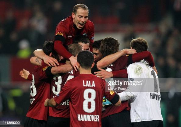 Jan Schlaudraff of Hannover celebrate with his team mates after the UEFA Europa League second leg round of 16 match between Hannover 96 and Standard...