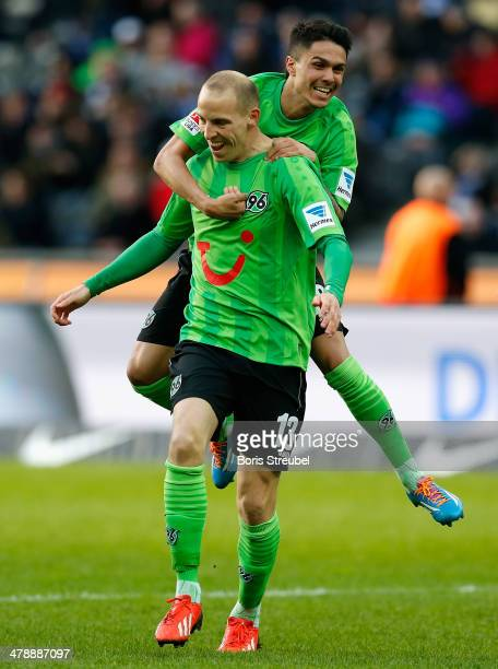 Jan Schlaudraff of Hannover celebrates after scoring his team's second goal with his team mate Leonardo Bittencourt during the Bundesliga match...