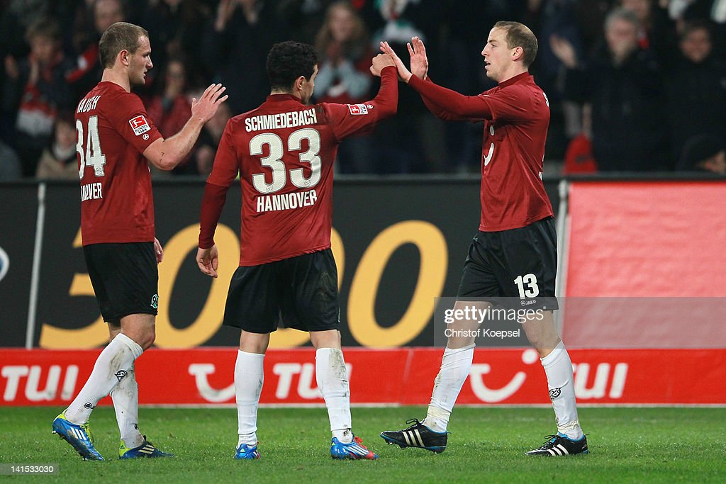Jan Schlaudraff of Hannover (R) celebrates the second goal with Deniz Aycicek (L) and Manuel Schmiedebach (C) of Hannover during the Bundesliga match between Hanover 96 and 1. FC Koeln at AWD Arena on March 18, 2012 in Hannover, Germany.