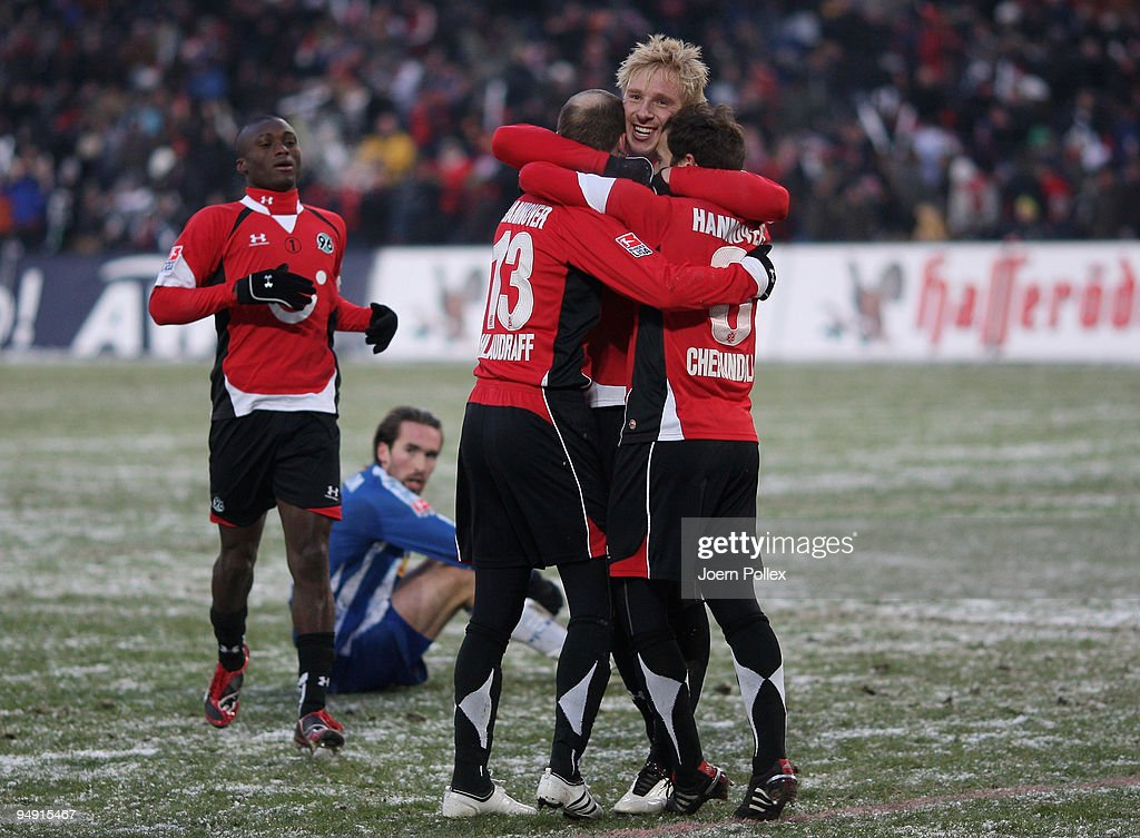 Jan Schlaudraff of Hanover celebrates with his team mates Steven Cherundolo and Mike Hanke after scoring his teams second goal during the Bundesliga...