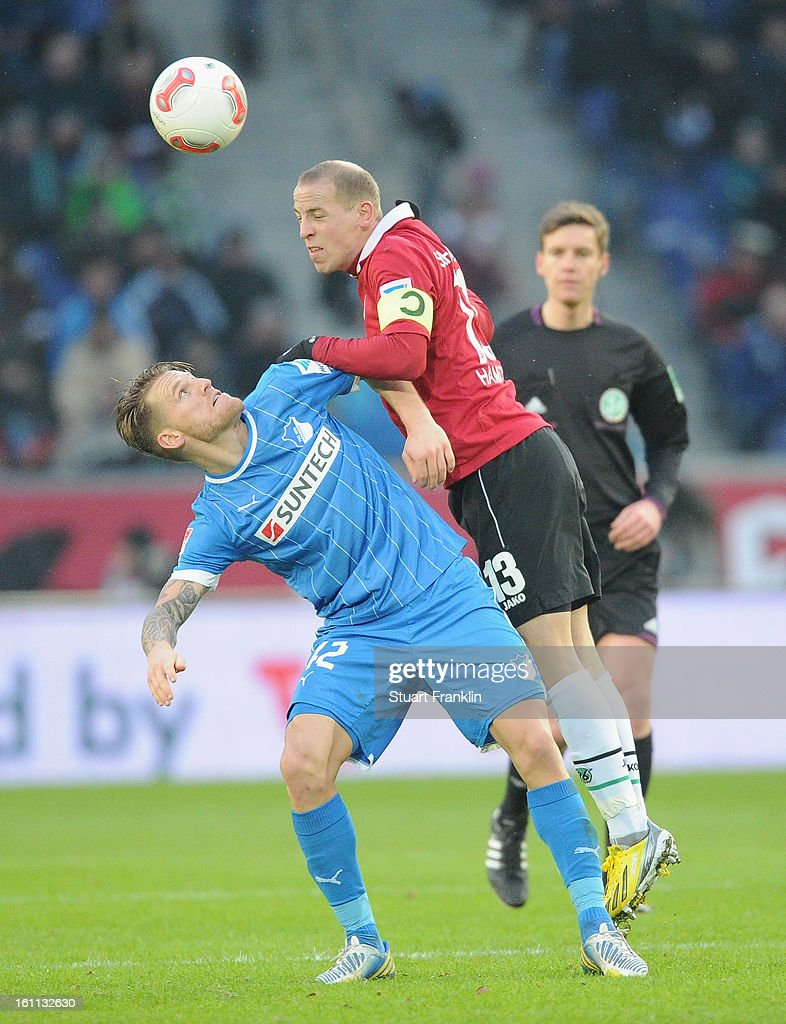 Jan Scxhlaudraff of Hannover is challenged by Eugen Polanski of Hoffenheim during the Bundesliga match between Hannover 96 and TSG 1899 Hoffenheim at AWD Arena on February 9, 2013 in Hannover, Germany.