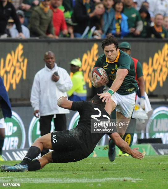 Jan Serfontein of South Africa beats Lima Sopoaga of New Zealand during the Rugby Championship 2017 match between South Africa and New Zealand at DHL...