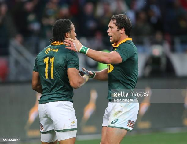 Jan Serfontein of South Africa congratulates Courtnall Skosan on his try during the Rugby Championship match between South Africa and Argentina at...
