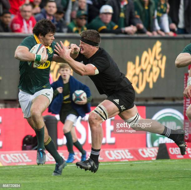 Jan Serfontein of South Africa tries to hand off Sam Whitelock of New Zealand during the Rugby Championship 2017 match between South Africa and New...