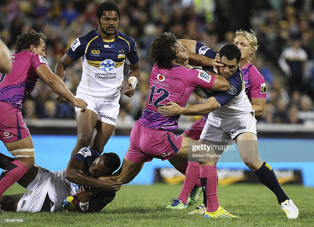 Jan Serfontein of the Bulls is tackled by <a gi-track='captionPersonalityLinkClicked' href=/galleries/search?phrase=George+Smith+-+Rugby+Player&family=editorial&specificpeople=15720629 ng-click='$event.stopPropagation()'>George Smith</a> of the Brumbies during the round seven Super Rugby match between the Brumbies and the Bulls at Canberra Stadium on March 30, 2013 in Canberra, Australia.