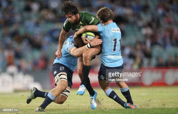 Jan Serfontein of the Bulls is tackled by Rob Horne of the Waratahs during the round 10 Super Rugby match between the Waratahs and the Bulls at...