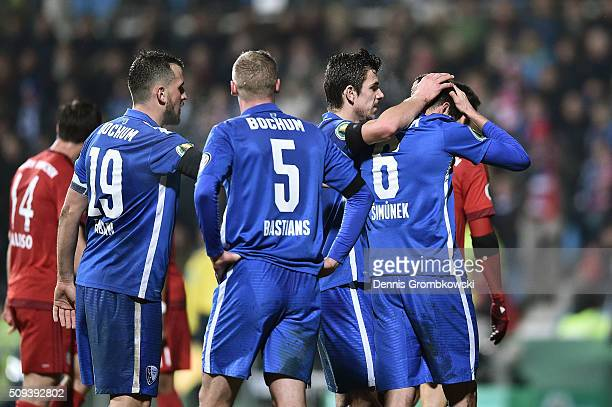 Jan Simunek of VfL Bochum is consoled by his team mates after being shown a red card during the DFB Cup quarter final match between VfL Bochum and...
