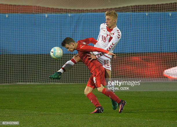 Jan Sykora of Czech Republic vies for a ball with Daniel Wass of Denmark during the friendly football match Czech Republic vs Denmark in Mlada...