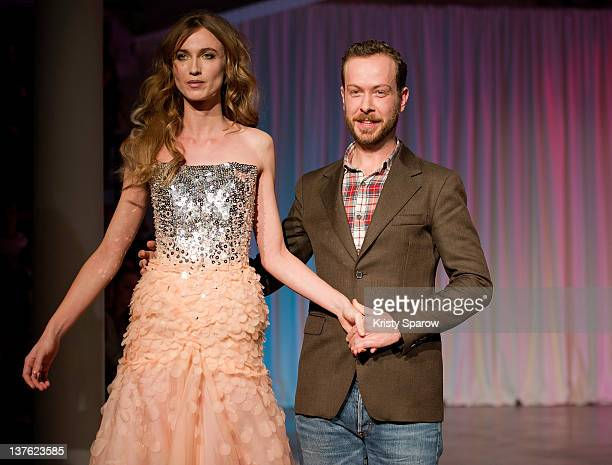 Jan Taminiau walks the runway with a model during the Jantaminiau HauteCouture 2012 show as part of Paris Fashion Week at Le Laboratoire on January...