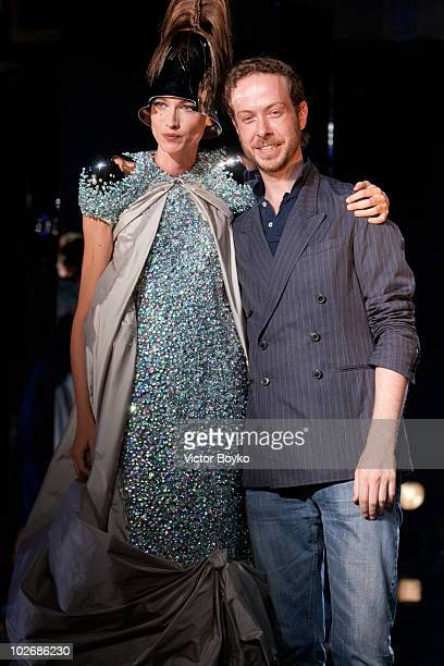 Jan Taminiau with model on the runway of the Jan Taminiau show as part of Paris Fashion Week Fall/Winter 2011 at BETC EURO RSCG on July 7 2010 in...
