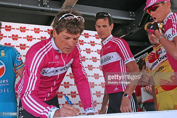 Jan Ullrich of Germany Team TMobile and Andreas Kloeden of Germany Team TMobile write in before stage one of the 70th Tour de Suisse between Baden...