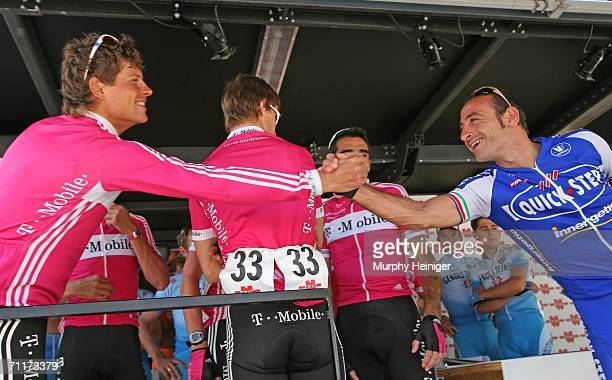 Jan Ullrich of Germany Team TMobile salutes Paolo Bettini of Team Quick Step before stage one of the 70th Tour de Suisse between Baden and Baden on...