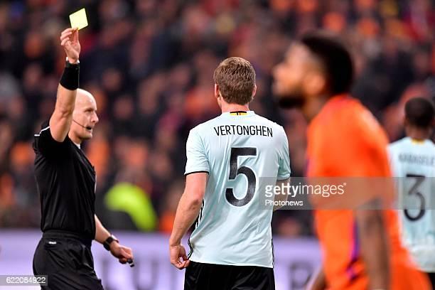 Jan Vertonghen defender of Belgium receives a yellow card ftom referee Szymon Marciniak during a FIFA international friendly match between The...