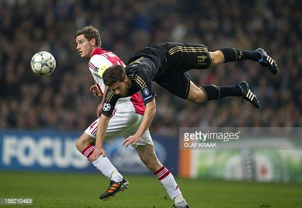 Jan Vertonghen of Ajax Amsterdam vies with Xabi Real Madrid's Alonso during the UEFA Champions League Group E football match between Ajax and Real...