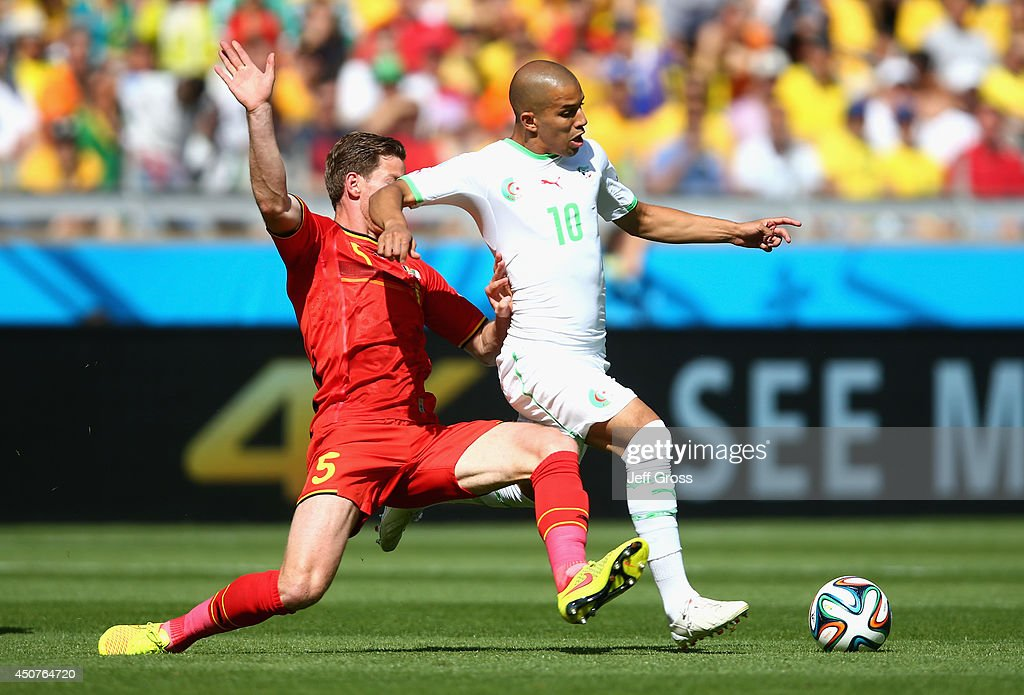 <a gi-track='captionPersonalityLinkClicked' href=/galleries/search?phrase=Jan+Vertonghen&family=editorial&specificpeople=1360499 ng-click='$event.stopPropagation()'>Jan Vertonghen</a> of Belgium challenges <a gi-track='captionPersonalityLinkClicked' href=/galleries/search?phrase=Sofiane+Feghouli&family=editorial&specificpeople=5485378 ng-click='$event.stopPropagation()'>Sofiane Feghouli</a> of Algeria during the 2014 FIFA World Cup Brazil Group H match between Belgium and Algeria at Estadio Mineirao on June 17, 2014 in Belo Horizonte, Brazil.