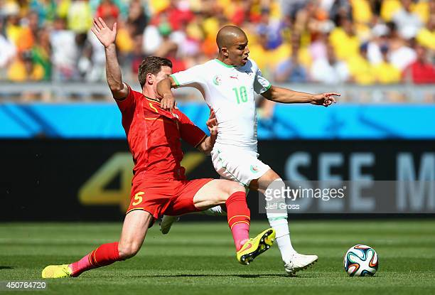 Jan Vertonghen of Belgium challenges Sofiane Feghouli of Algeria during the 2014 FIFA World Cup Brazil Group H match between Belgium and Algeria at...