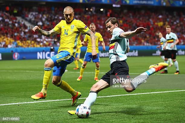 Jan Vertonghen of Belgium crosses under pressure from Victor Lindelof of Sweden during the UEFA EURO 2016 Group E match between Sweden and Belgium at...