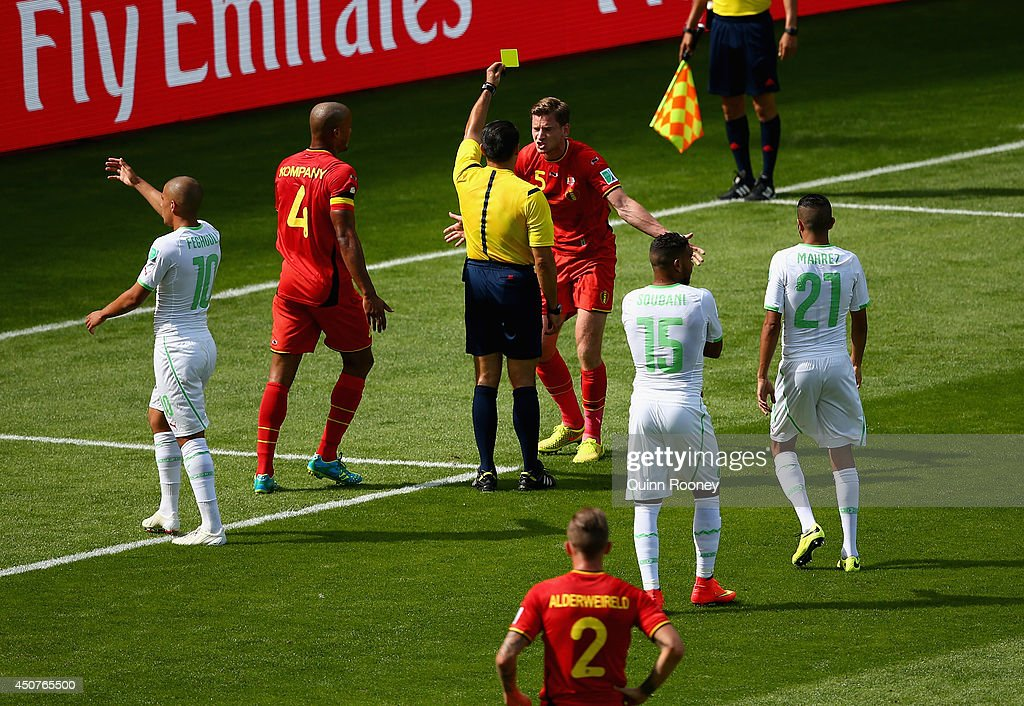 <a gi-track='captionPersonalityLinkClicked' href=/galleries/search?phrase=Jan+Vertonghen&family=editorial&specificpeople=1360499 ng-click='$event.stopPropagation()'>Jan Vertonghen</a> of Belgium is shown a yellow card by referee Marco Rodriquez after a foul on Sofiane Feghouli of Algeria (L) resulting in a penalty kick during the 2014 FIFA World Cup Brazil Group H match between Belgium and Algeria at Estadio Mineirao on June 17, 2014 in Belo Horizonte, Brazil.